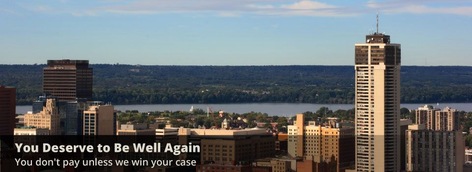 You deserve to be well again - You don't pay unless we win your case | Hamilton, Ontario skyline | Karn Malhotra lawyer